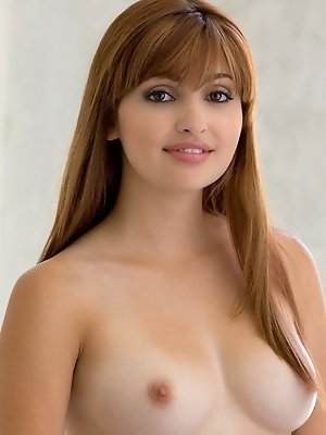 Sweet, full lipped, auburn haired Natasha has a classic apple bottom and pale rose nipples that look deliciously sensuous.